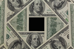 USD frame. Money frame made from one hundred dollars banknotes isolated on black background Stock Image