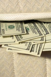 Usd notes. Money under the matress, currencies Stock Photos