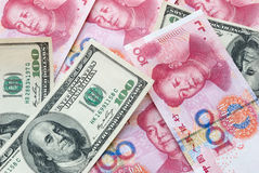 USD and RMB. USD 100 and RMB 100 Royalty Free Stock Photos