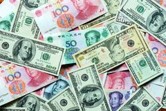 USD and RMB bank notes. Pile of USD and RMB bank notes as money background Royalty Free Stock Photos