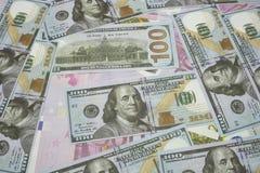 100 Usd y 500 billetes de banco euro Imágenes de archivo libres de regalías