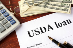 USDA loan form. And documents on a table royalty free stock photos