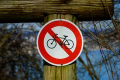 Old sign pohibiting cycling in the woods stock photo