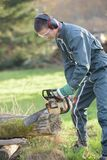 Use chainsaw. The use of a chainsaw stock images