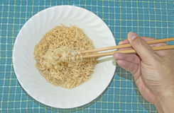 Use chopstick to eat Instant Noodle Stock Photo