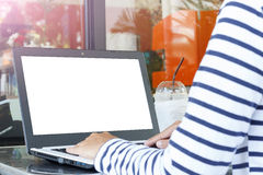 Use computer outdoor. Women use computer in coffee shop, outdoor Royalty Free Stock Photos