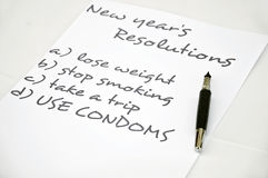 Use condoms. New year resolution use condoms Stock Photos