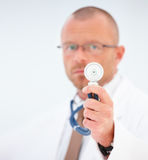We use this - Doctor showing stethoscope Royalty Free Stock Photos