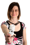 Use this energy saving lamp. Woman holding an energy saving fluorescent lamp Stock Photos