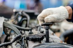 Use the engine to remove the spark plugs. stock images