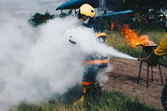 Use a fire extinguisher to fire at the Firefighters royalty free stock photos