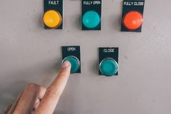 Use hand is adjust switch on Electrical control cabinet Royalty Free Stock Photo