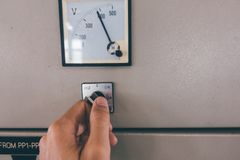 Use hand is adjust switch on Electrical control cabinet Royalty Free Stock Image