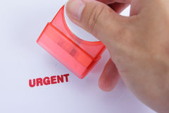 Use hand for stamp Urgent case Stock Photo