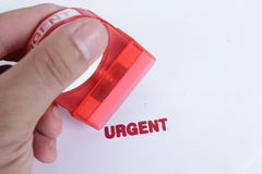Use hand for stamp Urgent case Royalty Free Stock Images