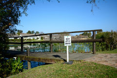 Use of jetty at own risk. Warning sign next to a jetty Stock Photography