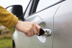 Use key open car door Stock Photos