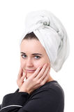 The use of medical procedures for body care. Real young woman in a black bathrobe over a white background Royalty Free Stock Photos