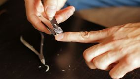 Use nail clipper cut the nails, short for good hygiene. Cut off fingernails. Cut off nails. Man trim nails. Guy clipping. Fingernails. FullHD stock footage
