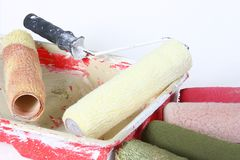 Use Paint Rollers. A view of used paint rollers with different colors on them Stock Photos