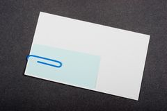 Use Paper Clip. White blank with note blank using blue paper clip Stock Photography