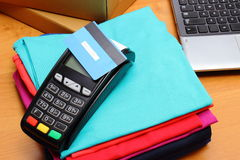 Use payment terminal with contactless credit card for paying for purchases Stock Images