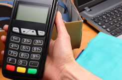 Use payment terminal for paying for purchases in store Royalty Free Stock Photo