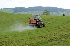 Use of pesticides in agriculture. On a field in spring stock photography