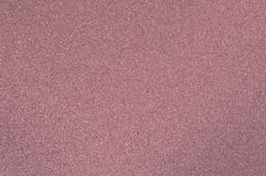 Use a polished granite texture of red color for the background. stock images
