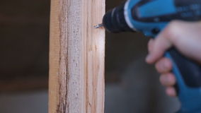 Use a screwdriver in the manufacture of wood products.  stock video