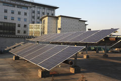 Use of solar power plants on the roof of buildings Stock Photo