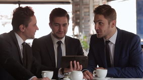 Use the tablet in a business meeting stock video