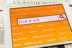 Use tablet search a job or  new career Royalty Free Stock Photo