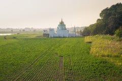 Buddhist temple at sunrise at Amarapura ,Mandalay,Myanmar. Use ultra wild lens for capture wild angle royalty free stock photography
