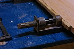 Use of a Vise for Gluing Wood Parts.Vise pressing. Use of a vise for gluing wood parts. Press vise Royalty Free Stock Images