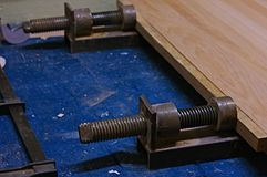 Use of a Vise for Gluing Wood Parts.Vise pressing. V2. Use of a vise for gluing wood parts. Press vise. V2 Royalty Free Stock Images