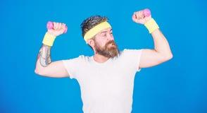 Use weights or dumbbells. Man bearded athlete exercising dumbbell. Athlete training with tiny dumbbell. Motivated. Athlete guy. Sportsman training with stock photography