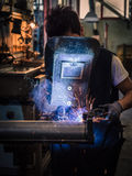 Use of wire welding machine in a workshop. Royalty Free Stock Images