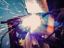 Use of wire welding machine in a workshop. Stock Images