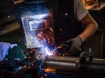 Use of wire welding machine in a workshop. Stock Photography