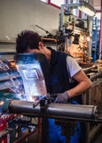 Use of wire welding machine in a workshop. Stock Photos