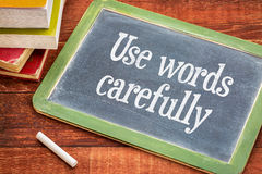 Use words carefully phrase on blackboard Stock Photos