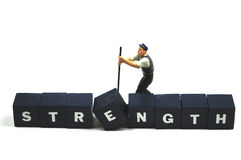 Use your strength. A man is using all his strength royalty free stock image