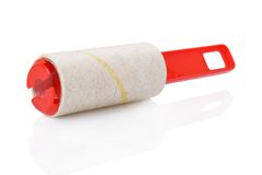 Used adhesive roller Stock Image