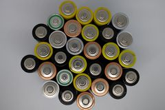 Top view of used alkaline batteries. Closeup of old AA batteries ready for recycling, colorful batteries - Image royalty free stock photo