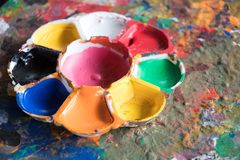 Used art palette on abstract mixed color background. Brush, paint, artistic, colorful, artwork, blue, red, yellow, white, watercolor, hand, oil, rainbow, flag stock photos