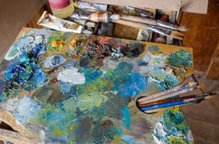 Used the artist`s palette, brushes, close-up. Royalty Free Stock Images