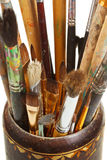 Used artistic paintbrushes in wooden cup closed up Stock Photos
