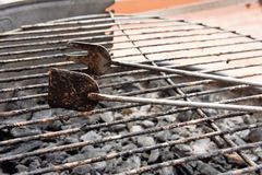 Used barbecue tongs royalty free stock photos