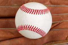Used baseball and glove in filled frame format Stock Photography